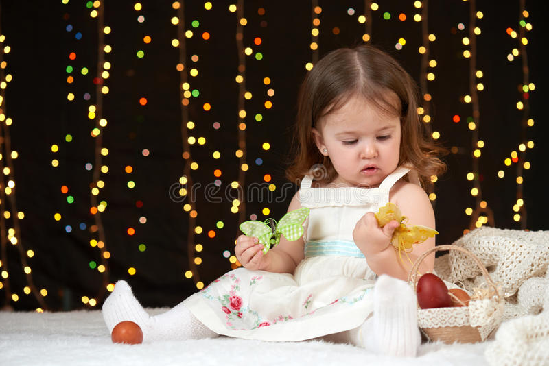Child girl portrait in christmas decoration, happy emotions, winter holiday concept, dark background with illumination and boke li stock photo