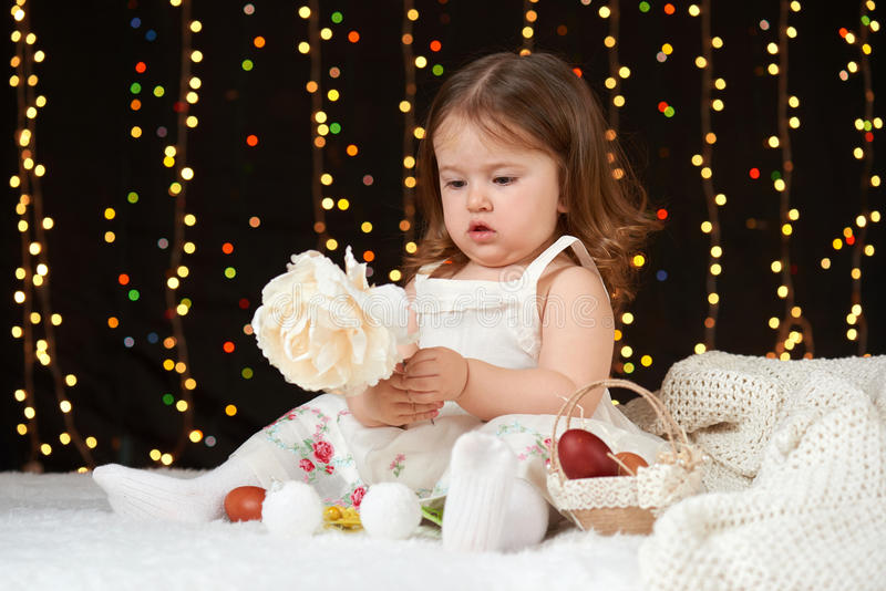 Child girl portrait in christmas decoration, happy emotions, winter holiday concept, dark background with illumination and boke li stock image