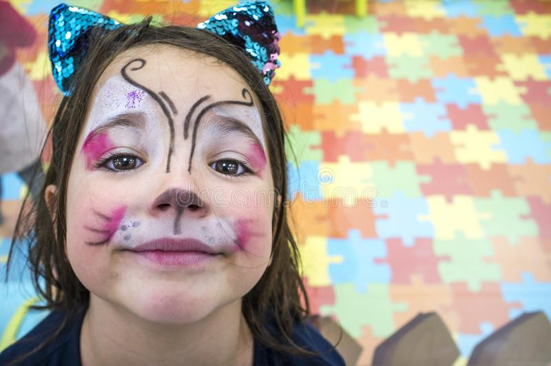 Child girl posing face painted during at Children Playroom. High angle shot royalty free stock photos