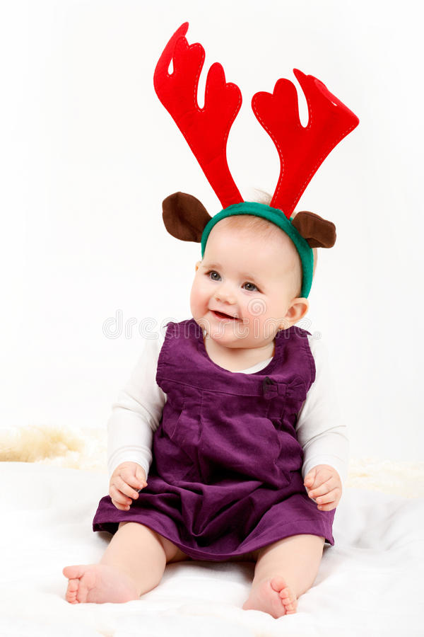 Child girl with reindeer antlers. On white background stock images