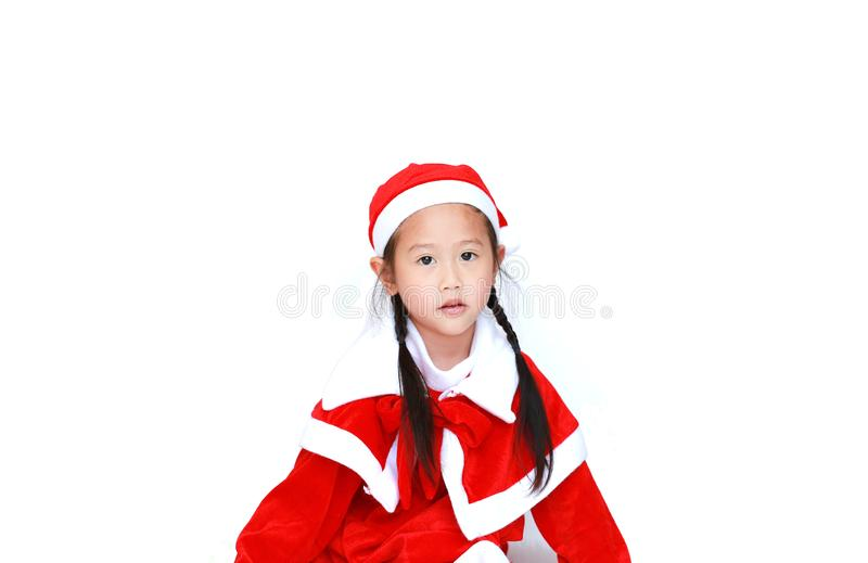 Child girl in Santa costume dress with copy space on white background. Merry Christmas and Happy New Year Concept.  royalty free stock images