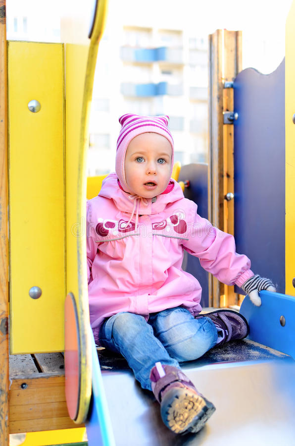 Download Child Girl Sitting On Slide Stock Image - Image: 24452357