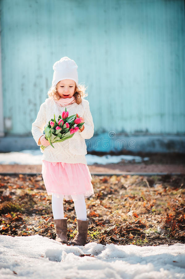Free Child Girl With Bouquet Of Tulips Having Fun On The Walk In Early Spring Royalty Free Stock Images - 50833259