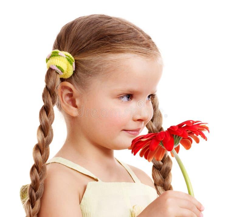 Child giving flower. stock photo