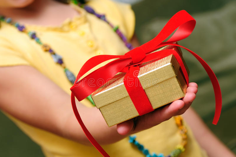 Child Giving Gift