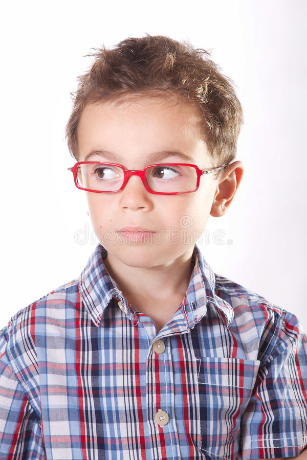 Child with glasses. Baby with red glasses on a white background royalty free stock photos