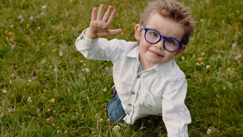 Child in glasses stock photography