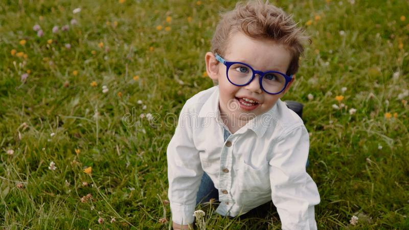 Child in glasses royalty free stock photos