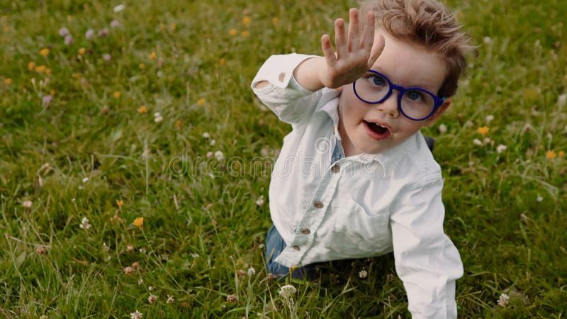 Child in glasses royalty free stock image