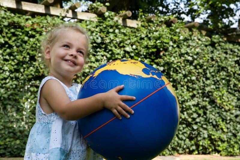 Child-globe2 photos stock