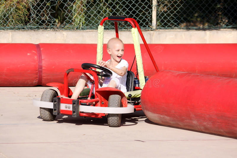 Child on go kart stock image