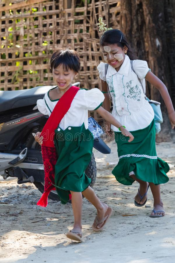 Child goes to elementary school in Ngapali beach, Myanmar royalty free stock image