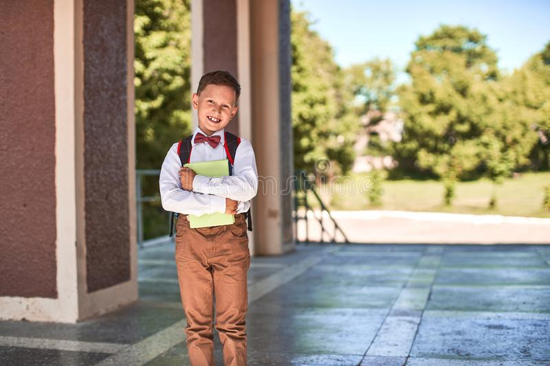 The child goes to primary school. portrait of a happy child with a briefcase on his back stock photos