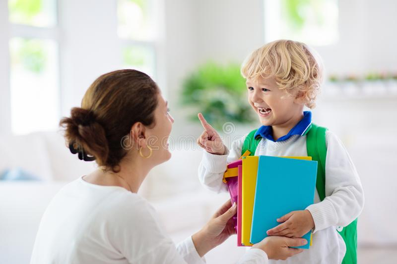 Child going back to school. Mother and kid stock images