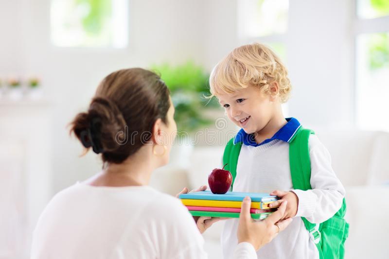 Child going back to school. Mother and kid stock photo