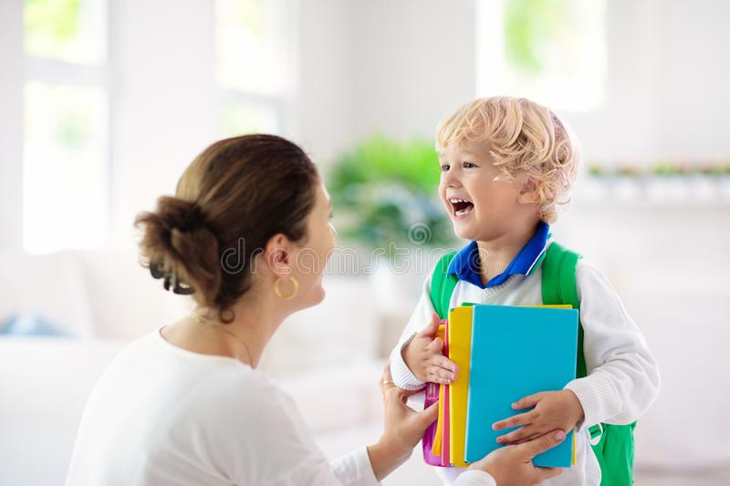Child going back to school. Mother and kid stock photos