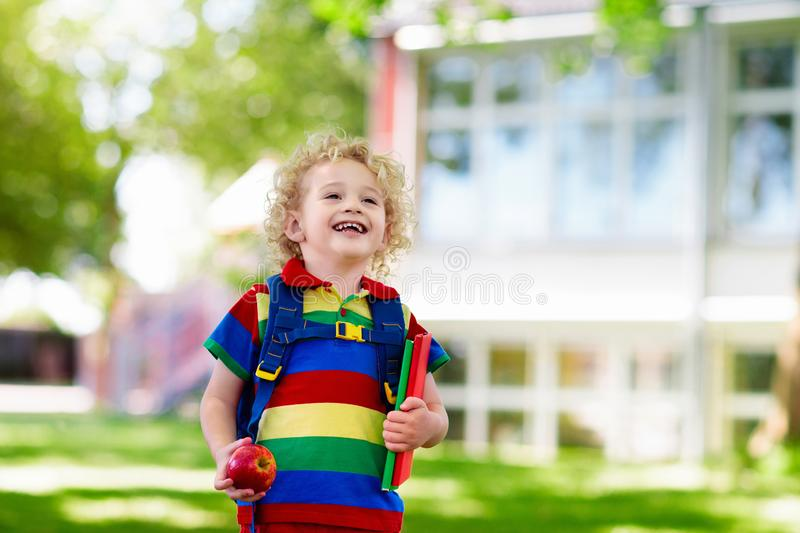 Child going back to school, year start. Child going back to school. Start of new school year after summer vacation. Little boy with backpack and books on first royalty free stock images