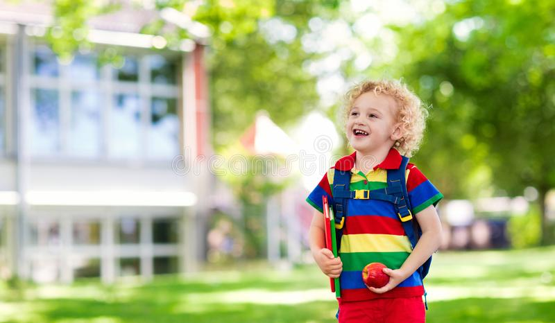 Child going back to school, year start. Child going back to school. Start of new school year after summer vacation. Little boy with backpack and books on first royalty free stock photo