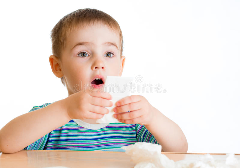 Child going to wipe with tissue royalty free stock images