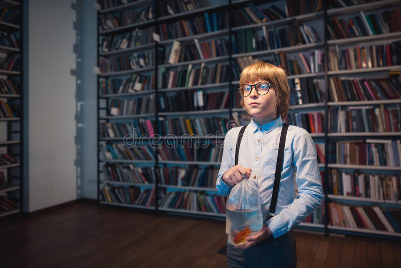 Child with goldfish royalty free stock images