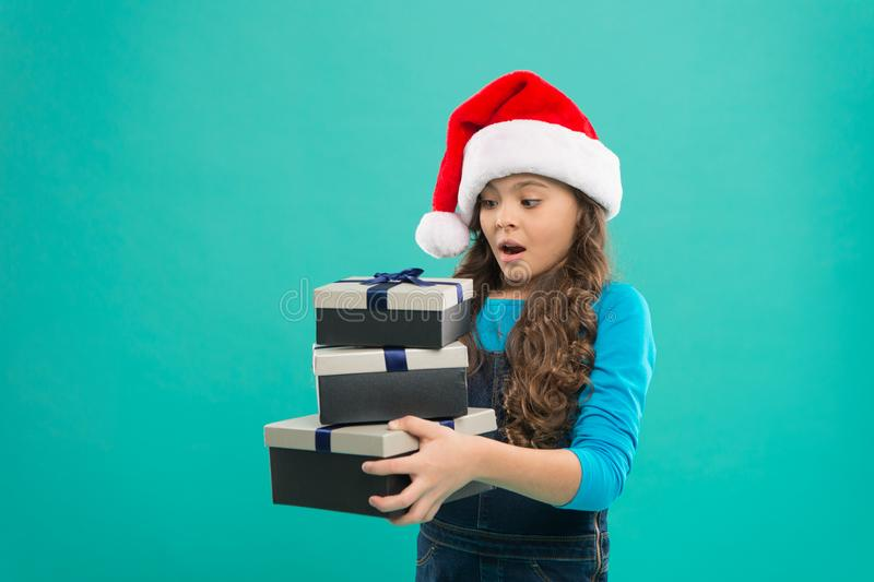 Child got surprise gift. Happy new year. Packaging for gifts. Lot presents. Christmas celebrated throughout globe. Small stock photos
