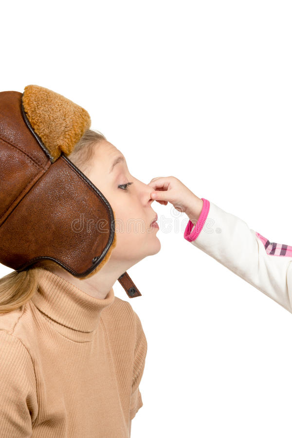 Child grabbed her motherhis nose royalty free stock image