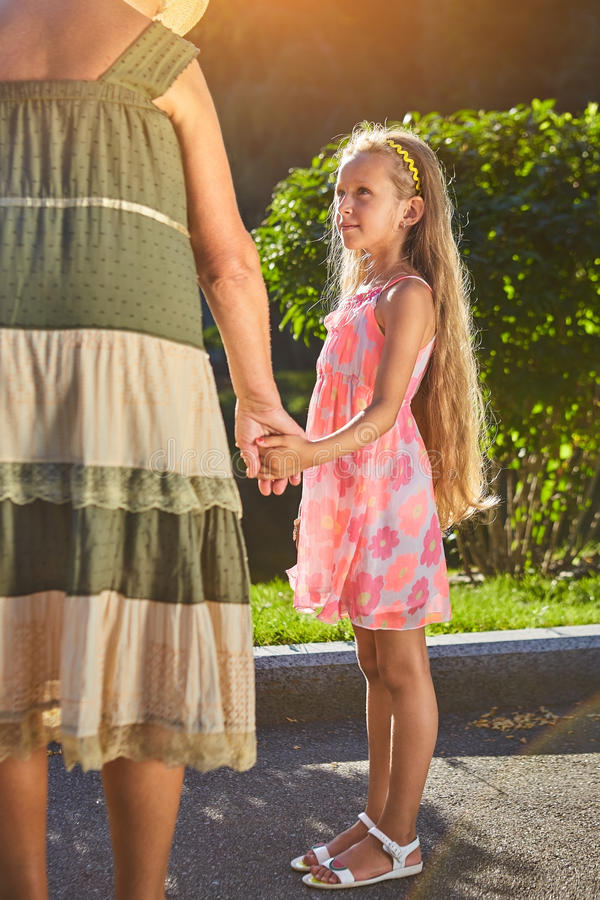 Child with grandmother holding hands. stock photography