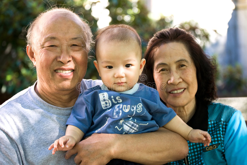 Child And Grandparents Royalty Free Stock Photos