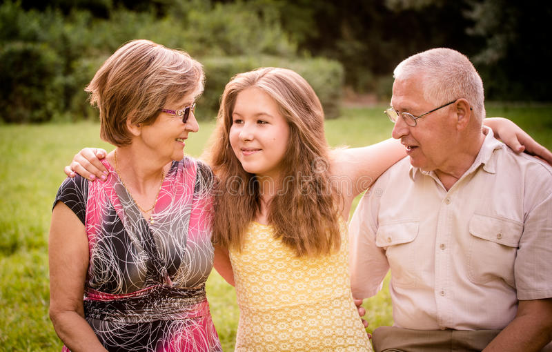 Child with grandparents royalty free stock photos