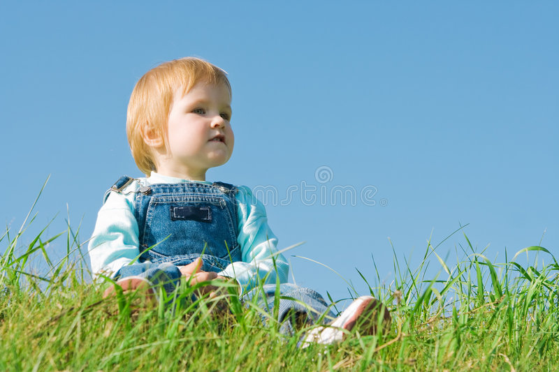 Child on green grass stock images