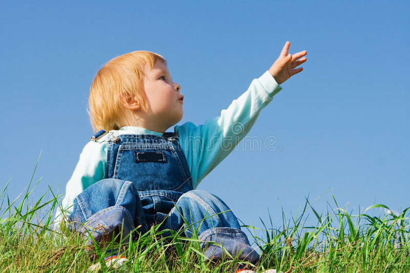 Child on green grass stock photography