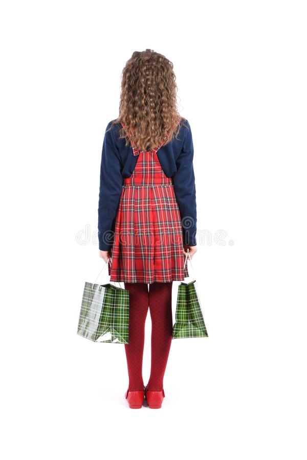 Child with a green packaging checkered texture isolated on white background. Girl likes shopping on sale season. Holiday present,. Shopping. Kid happy shopping royalty free stock images