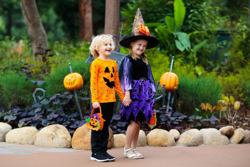 Child in Halloween costume. Kids trick or treat stock photo
