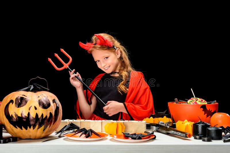 Child with halloween decorations and sweets stock image