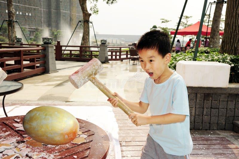 Download A Child Hammer A Golden Egg Stock Image - Image: 14345351