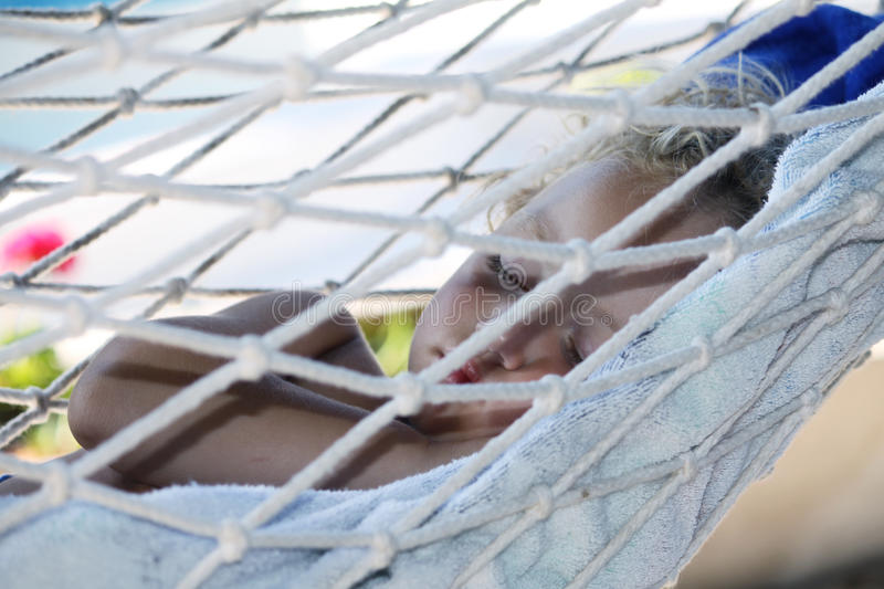 Child in hammock stock images