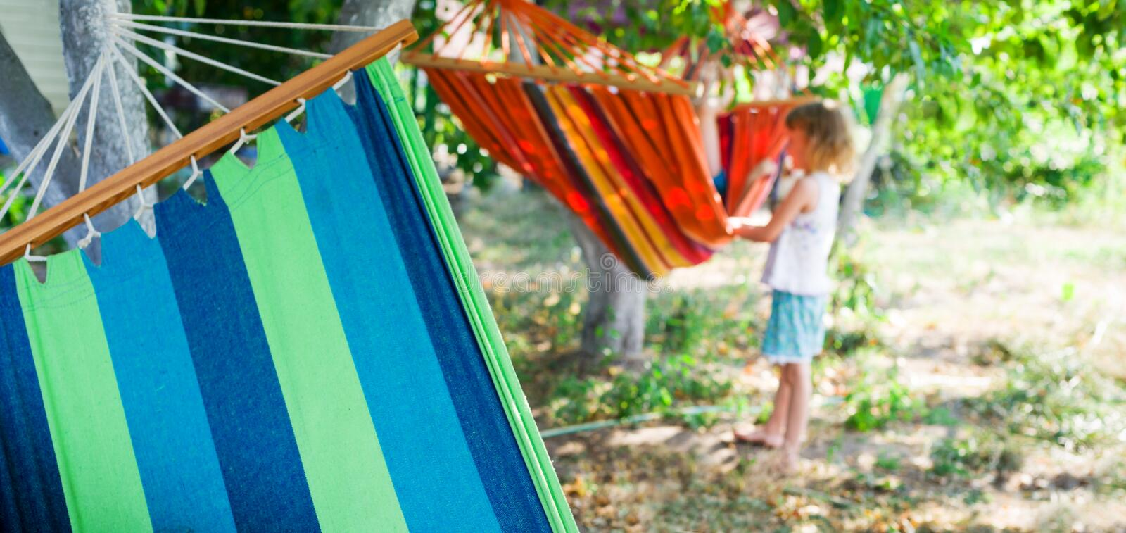Child with hammock. In backyard at summer stock photography