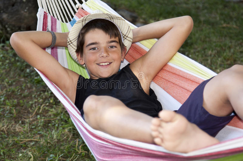 Child in the hammock royalty free stock images