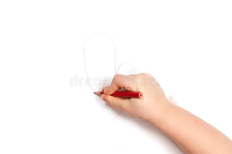 Child hand draws the heart stock photography