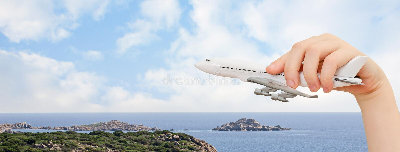 Child hand holding model airplane. royalty free stock image