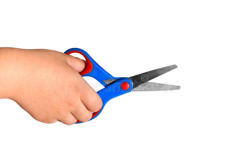 Child hand holding paper scissors stock images