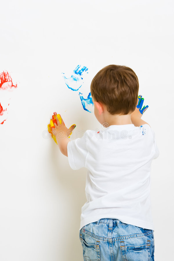 Child hand prints on the wall stock photography