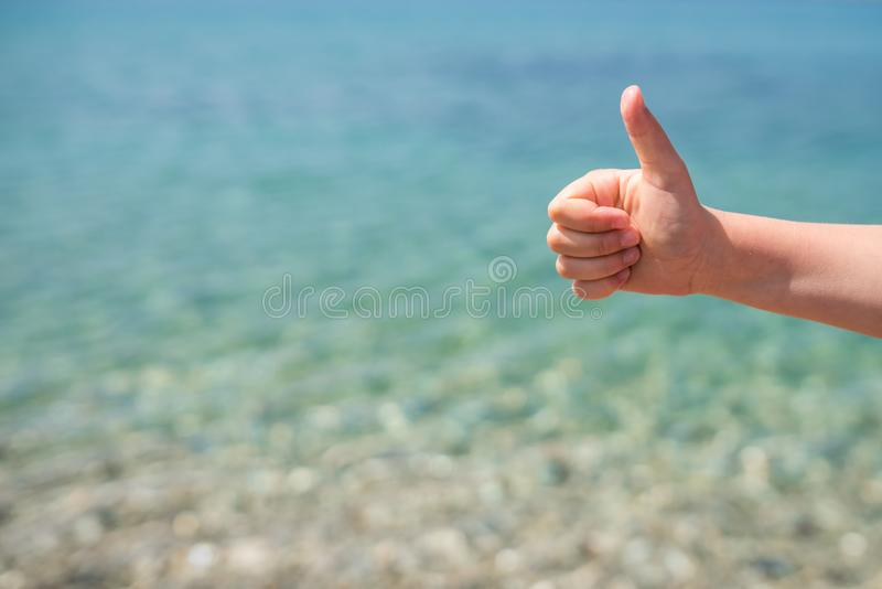Thumbs up on the beach royalty free stock photo