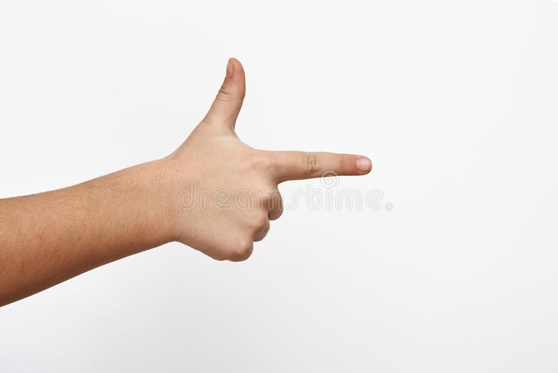 Child hand shows two fingers making gun sign royalty free stock photos