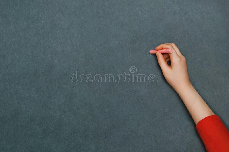 Child hand writing with chalk. stock image
