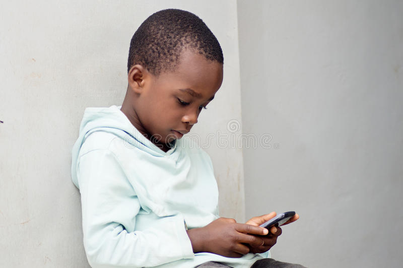Child handling a cell phone. stock photo