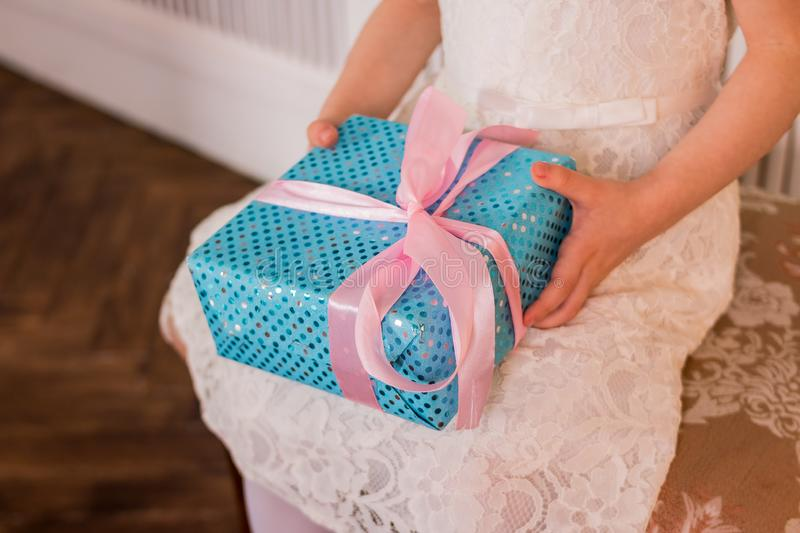 Child hands holding gift box. Copy space. Christmas, hew year, birthday concept. Festive day. Magic fairy tale.surprise. Female hands holding gift box. Copy royalty free stock photo
