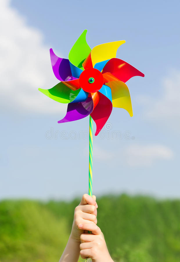 Child hands holding pinwheel. royalty free stock photography