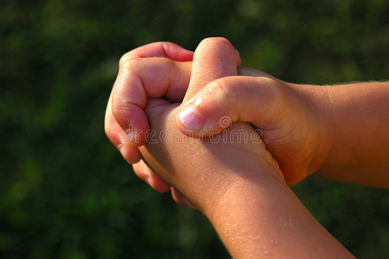 Child hands praying stock photography