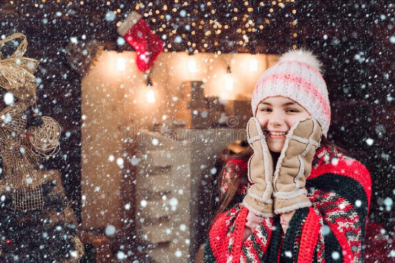 Child happiness celebrate New Year. Daughter hold Parent from Parent. Cute little teenager celebrating Christmas. Winter royalty free stock photography